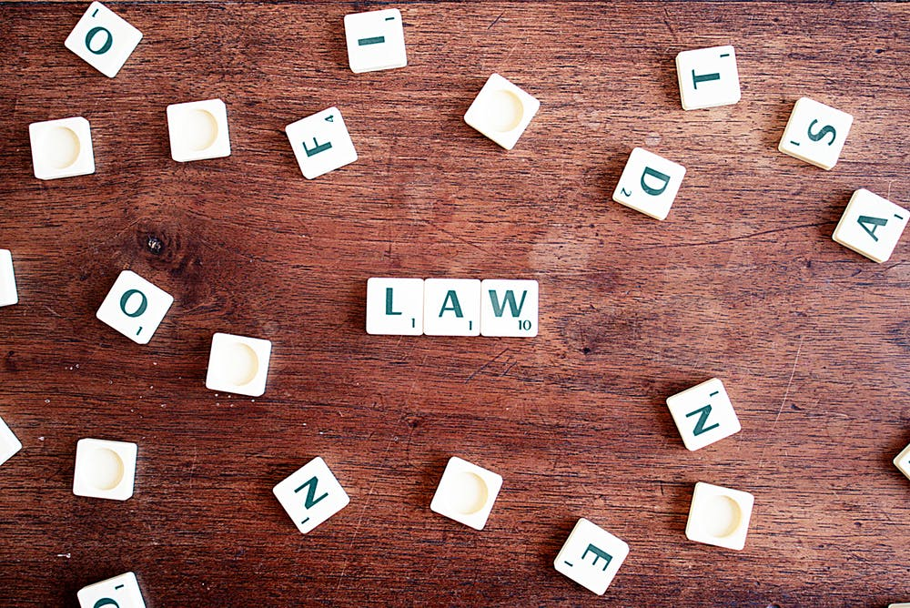 "Scrabble tiles showing the word ""law"""