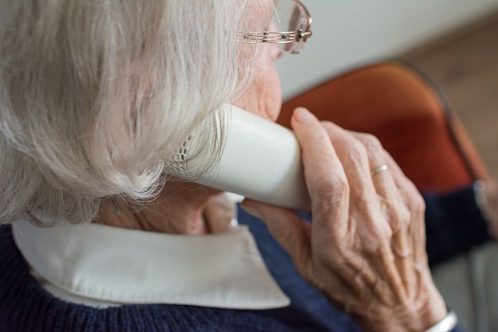 Old woman inquiring about aged care finance over the phone
