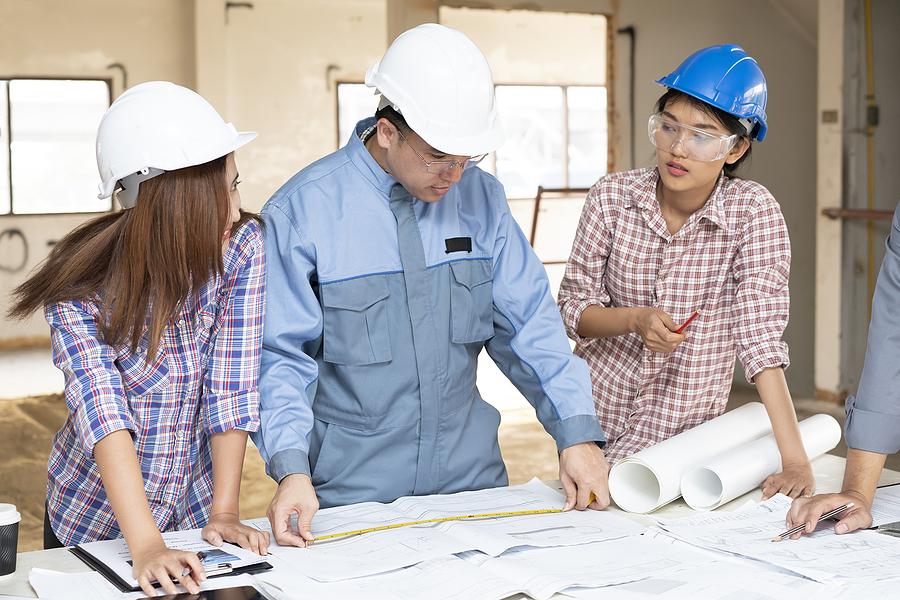 Three young people taking engineering internships