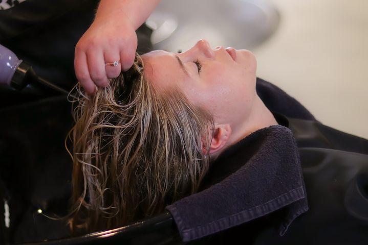 Woman getting a hair treatment in a beauty salon