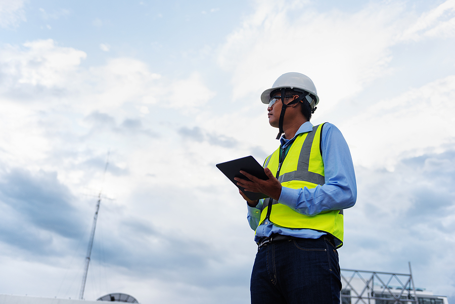 Engineer using a site diary