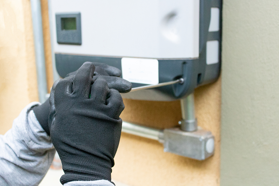 Worker installing a 3 phase inverter