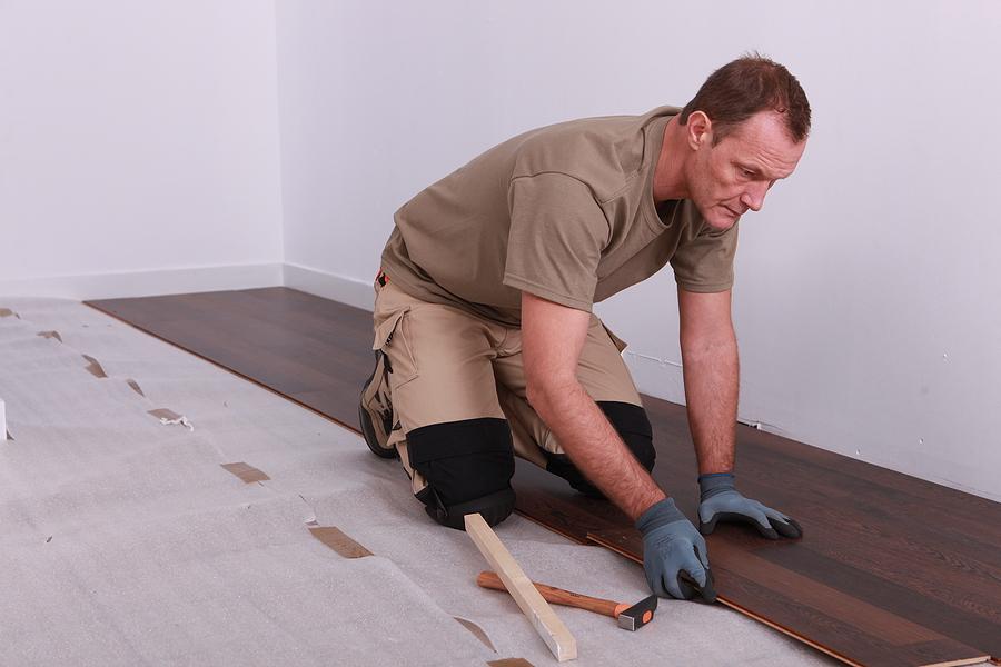 Timber floor installers in Sydney laying laminate flooring